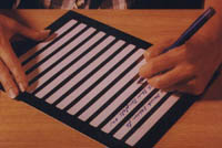 Picture of a large-scale writing tablet for the visually impaired