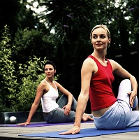 Photo of two women doing a yoga stretch