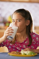 Photo of young teen girl drinking milk