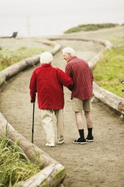 Photo of older couple walking on path