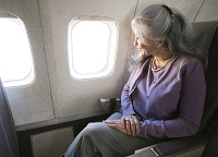Photo of woman in a window seat on a jetliner