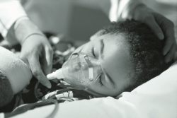 Child with oxygen mask