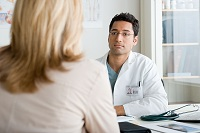 Photo of woman talking with her doctor