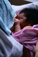 Photo of newborn nursing