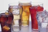 Photo of several glasses of soda with ice