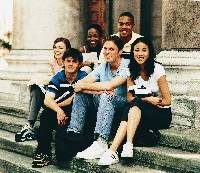 Photo of a group of teens sitting on school steps