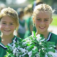 Photo of two young girls as cheerleaders
