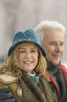 Photo of an older couple outdoors in the snow