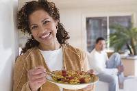 Photo of a woman holding a bowl of cereal