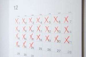 Image of a calender with several days filled with a red