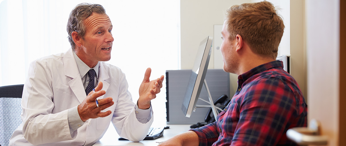 Doctor speaking with patient in office