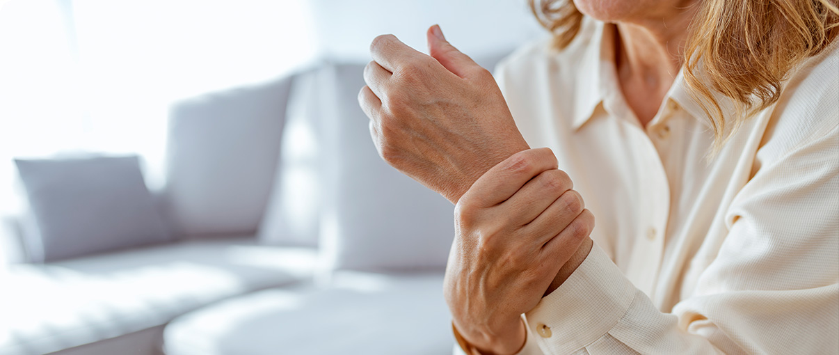 Woman holding her wrist from pain