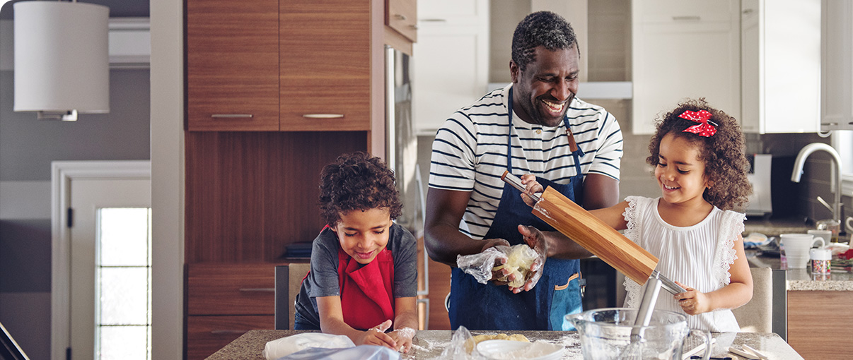 Father baking with children in kitchen